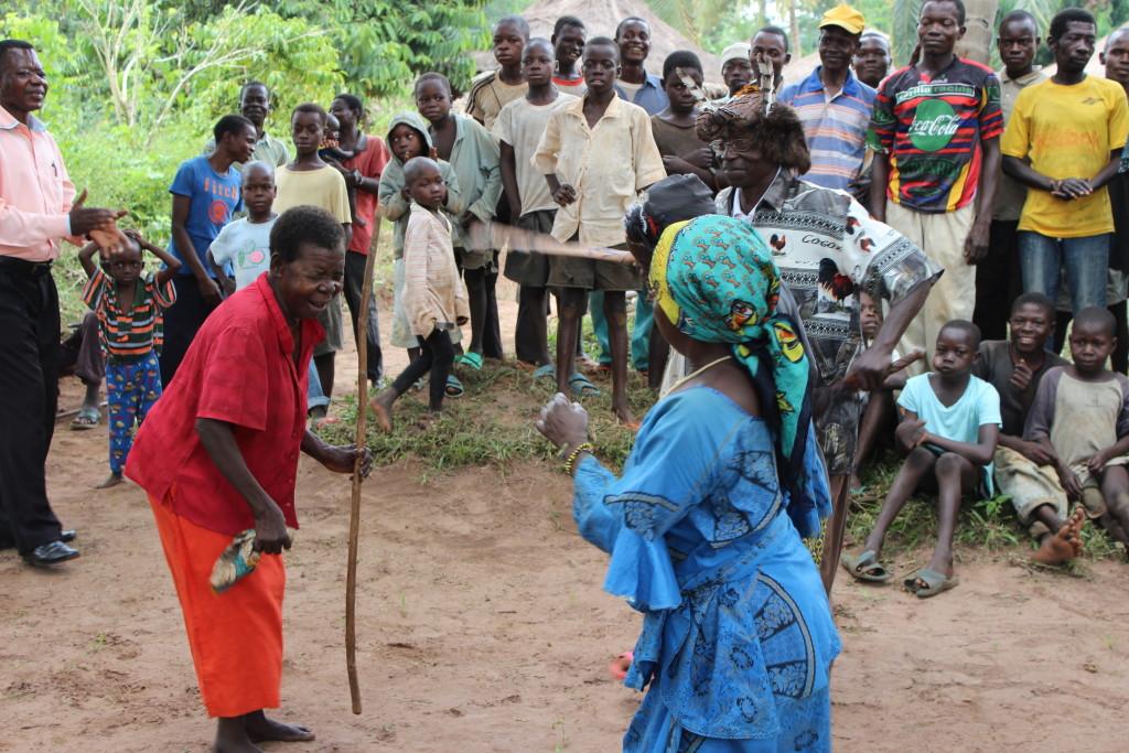 Two women dance during a festive meeting in Bokumu Mokola.