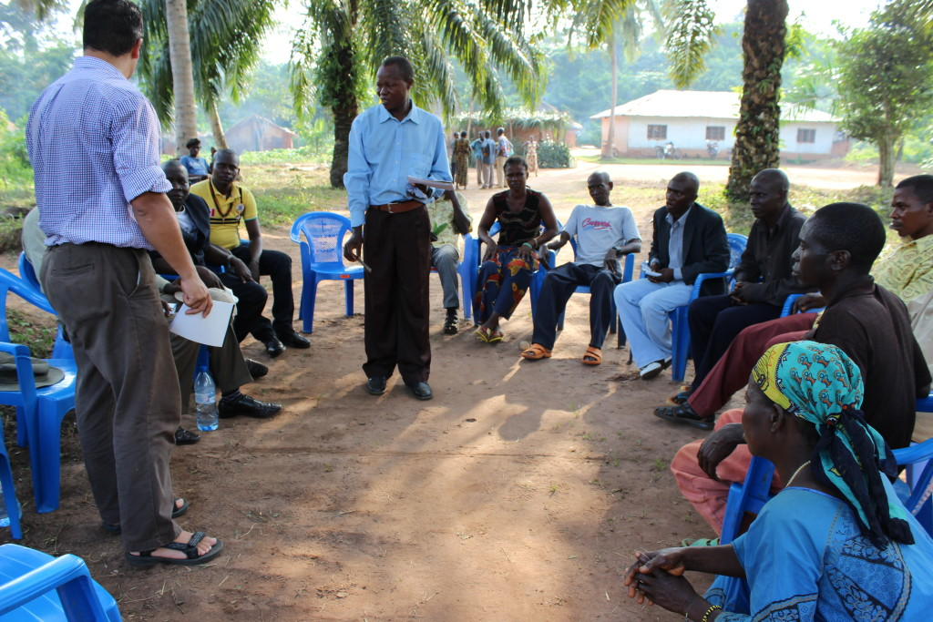 Village boundaries are discussed during a meeting in Bokumu Mokola.