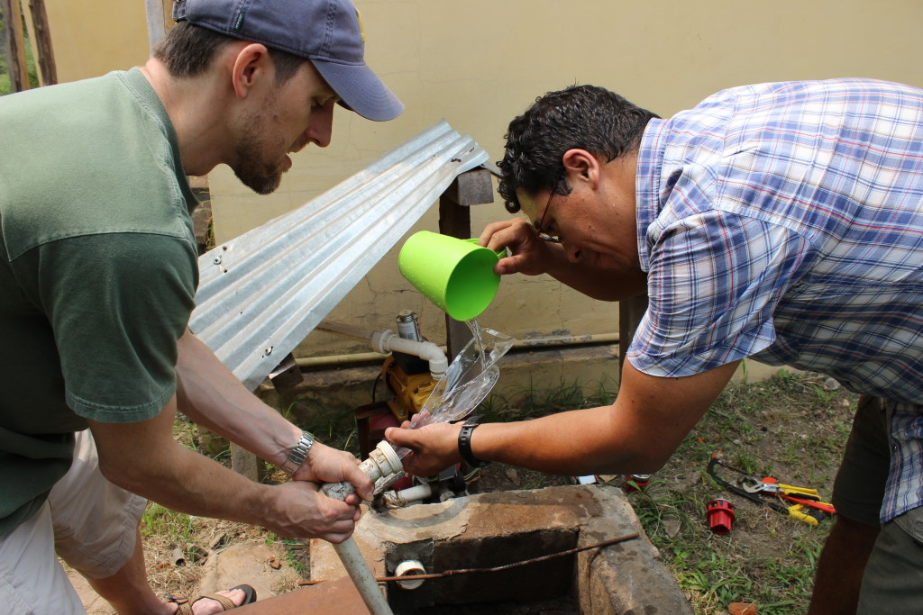 Living in Équateur is not always easy--here Dr. Walker and Dr. Bush attempt to install a pump in the well outside.